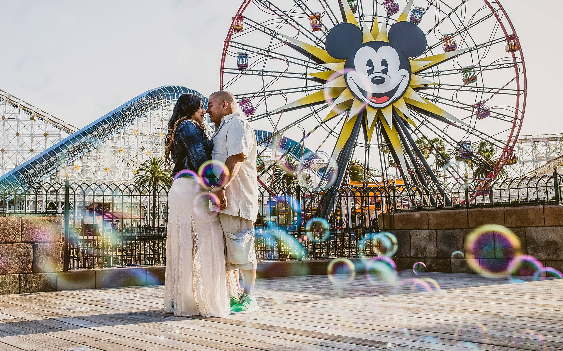 engagement at disneyland with bubbles california adventure mickey mouse ferris wheel