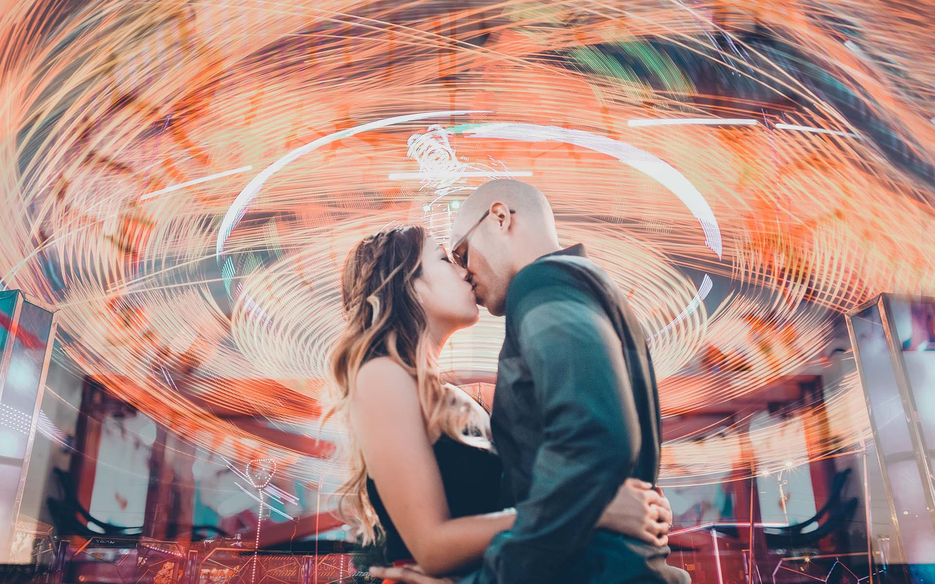 Orange County Fair engagement session with slow shutter effect creating light painting rides