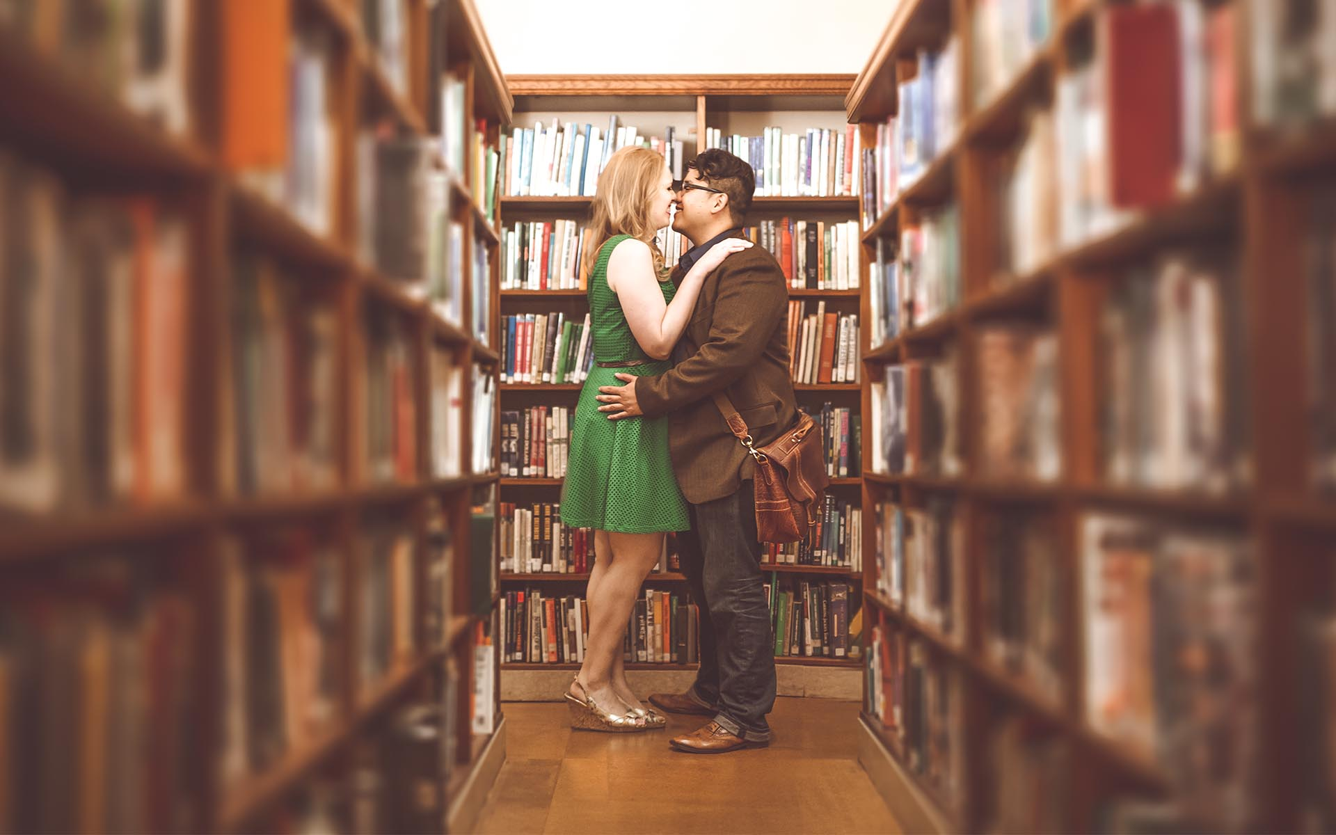 engagement photography between bookcases in los angeles library